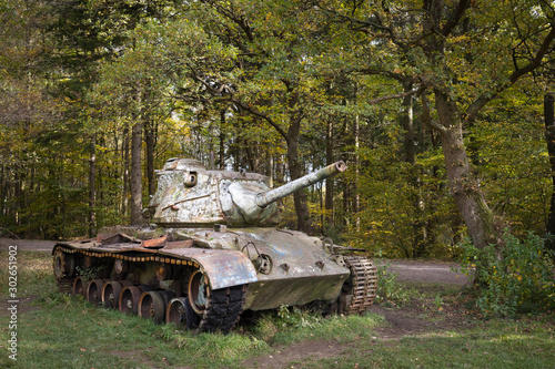 Canvas Print Abandoned Nato tank decaying in a forest in Germany