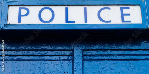 Wallpaper Mural Police sign on top of old blue police box
