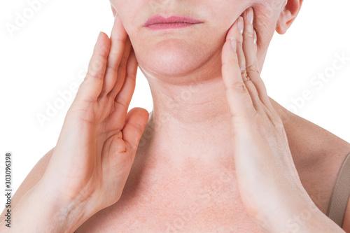 Slika na platnu Flabby skin on the neck of an elderly woman isolated on white background