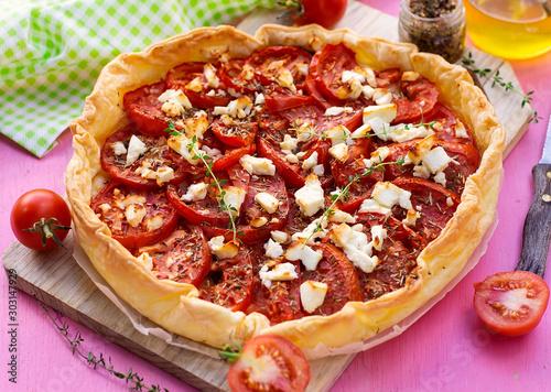 Obraz na płótnie Savoury tomato tart with mustard, feta cheese and thyme