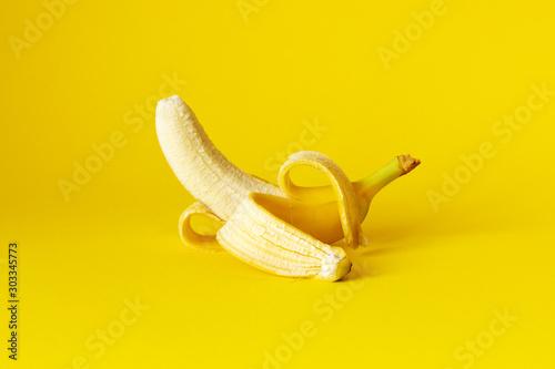 Cuadros en Lienzo peeled banana on yellow background