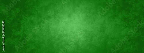 green Christmas background banner with metal texture design and soft center l...