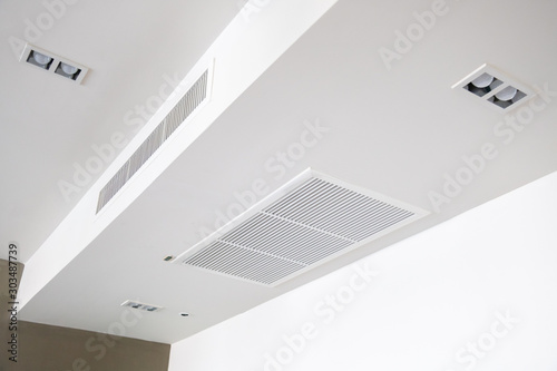 Fotomural Ceiling mounted cassette type air conditioner.