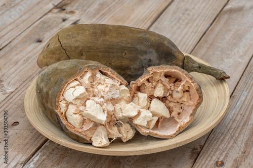 Baobab fruit or Adansonia digitata on plate, pulp and powder, superfood on the island of Zanzibar, Tanzania, east Africa Fototapeta