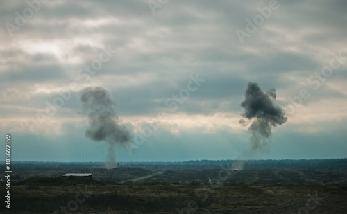 Fotografiet Two air force jets bombing targets at military trainings