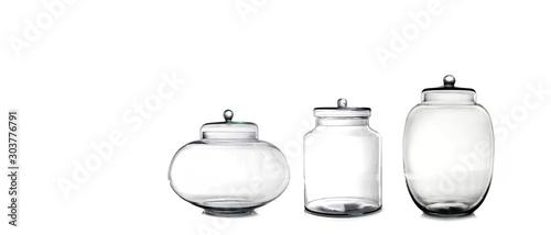 Fotografija Empty glass jars isolated on white background
