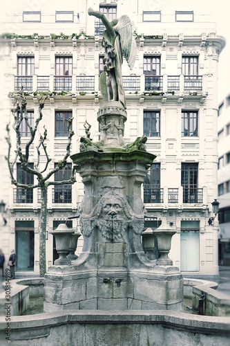 Ancient fountain in the town square. Corunna is famous touristic city and municipality of Galicia, Spain.