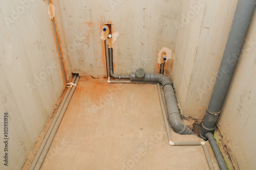 Canvas Print Domestic plumbing and sewage pipes connections in house construction