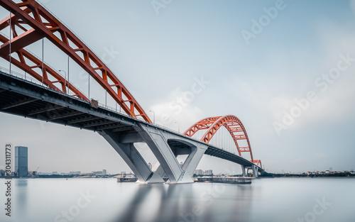 Suspension iron chain bridge in blue sky  guangzhou china