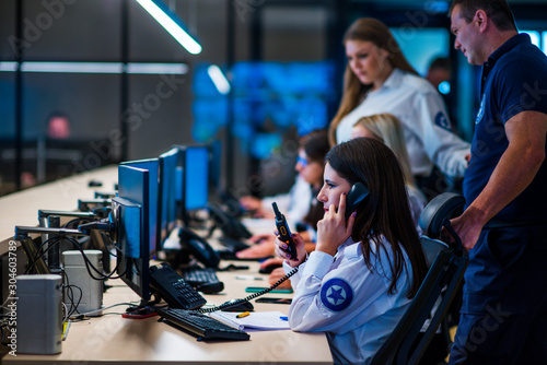 Fotografie, Obraz Security guards working in surveillance room
