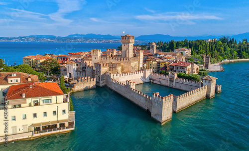 Fotografie, Obraz Aerial view to the town of Sirmione, popular travel destination on Lake Garda in