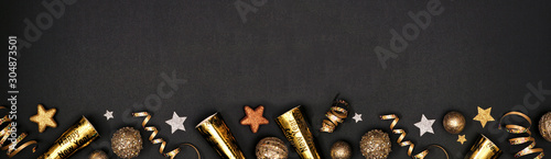 Fotografie, Tablou New Years Eve border banner of glittery gold stars, streamers, decorations and noisemakers