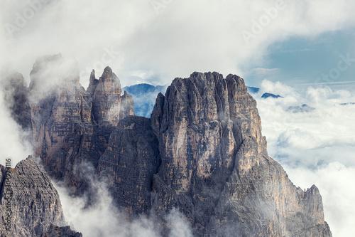 Fotografia, Obraz Amazing rocky mountains covered with clouds, Tre Cime di Lavaredo park, Dolomite