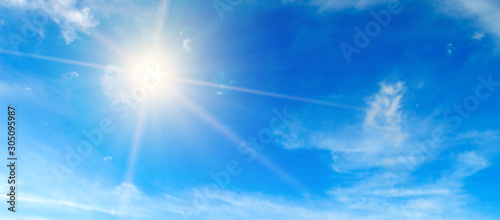 Fotografie, Obraz Blue sky. Bright midday sun illuminates the space. Wide photo .