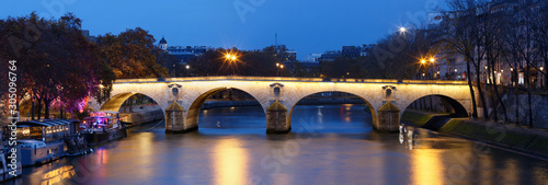 The Panoramic view of bridge Ponte Marie over Seina river at night , Paris, Europe.