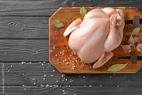 Raw chicken with spices on wooden background Fototapeta