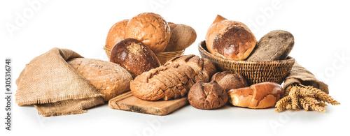 Assortment of fresh bakery products on white background