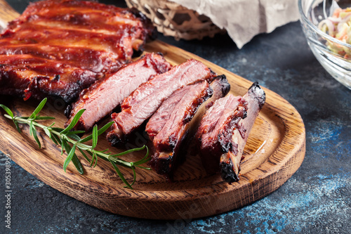 Fototapeta Spicy barbecued pork ribs served with BBQ sauce
