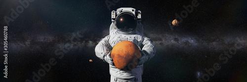 astronaut holding Mars, Phobos and Deimos orbiting the planet Fototapete