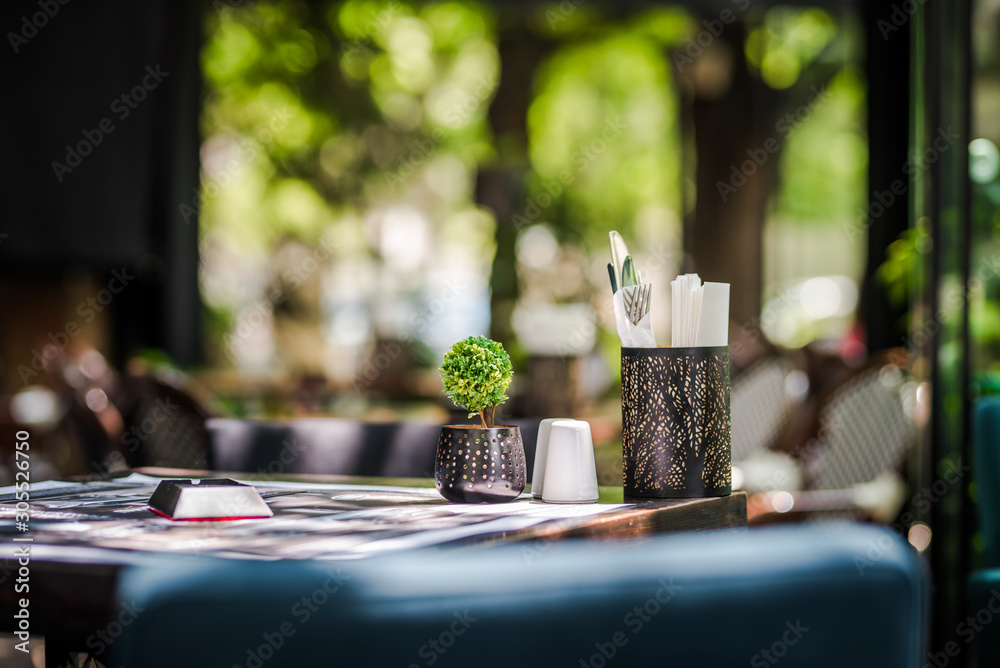 Simple and elegant outdoor restaurant table set up on  green background