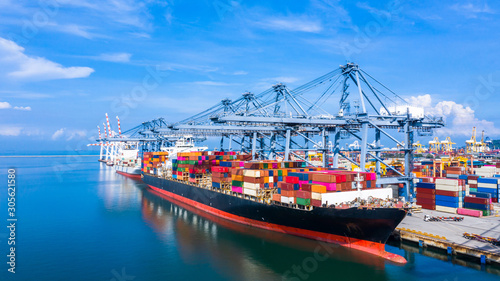 Fotografie, Tablou Container cargo ship at industrial port in import export business logistic and transportation of international by container cargo ship in the open sea