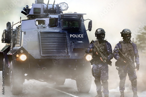 Police special force on standby infront of the armored vehicles during special opps