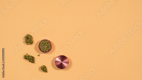 Tablou Canvas Top view of grinder with fresh marijuana buds on the yellow background, Flat lay