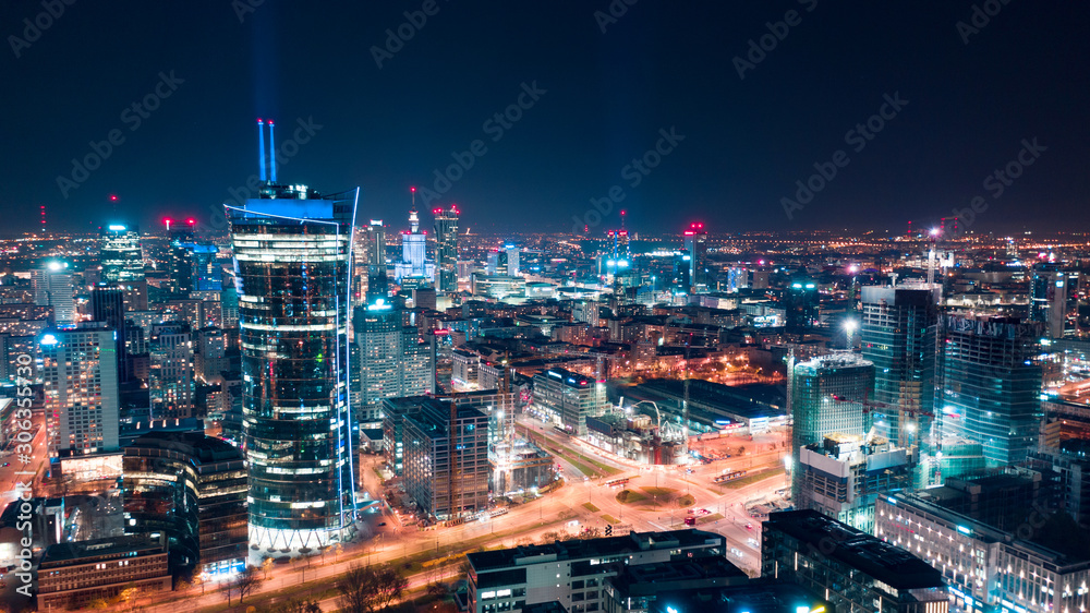 Aerial view of Warsaw business center at night: skyscrapers and Palace of Science and Culture