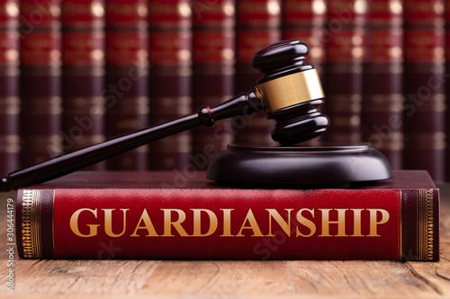 Gavel And Striking Block Over Guardianship Law Book Fototapeta