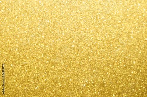 Abstract gold glitter sparkle bokeh light background
