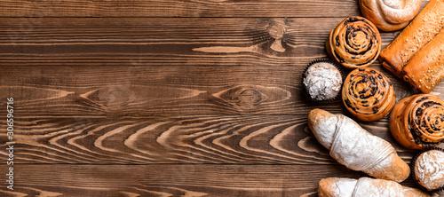 Obraz na płótnie Tasty pastries on wooden background