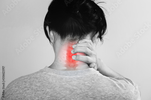 Fototapeta Neck Pain. a man touching neck at pain point