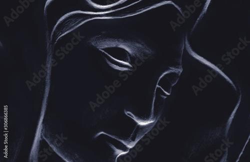 Fotografie, Obraz Silhouette of Virgin Mary against black background.