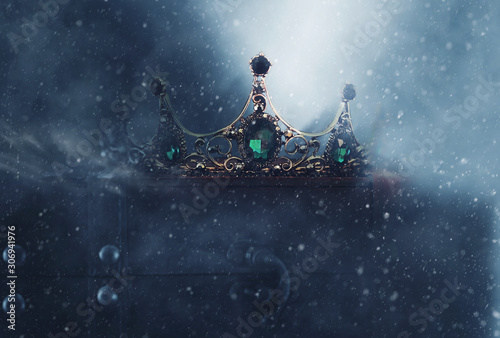 mysterious and magical photo of of beautiful queen/king crown over gothic snowy dark background Fototapet
