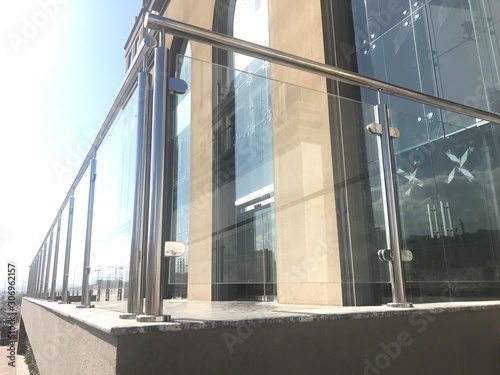 An Stainless steel glass transparent handrails with hairline finish fixed at lob Fototapet