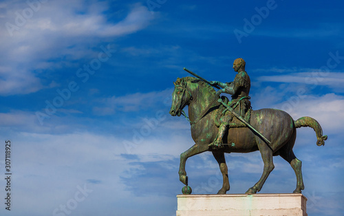 Canvas Print Gattamelata bronze equestrian statue among clouds, in the historic center of Pad