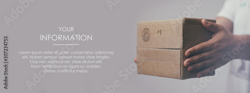 Deliveryman hold parcel box. Freight transportation. Express delivery. Web article template. Long header banner format. Sale coupon. Visit card. Your information. Text space.