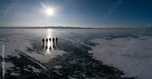 people silouette over ice from aerial view