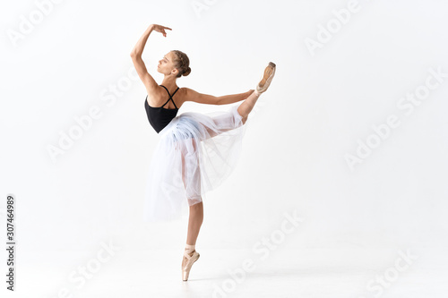 Carta da parati young dancer in action isolated on white