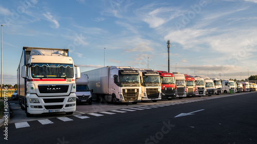 Photo Row of trucks on a truck parking along the E17 highway in Belgium on June 23, 20