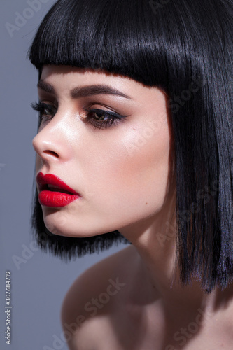 Stampa su Tela Profile photo of a young beautiful brunette model with colorful professional mak
