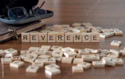 Fotomural reverence the word or concept represented by wooden letter tiles