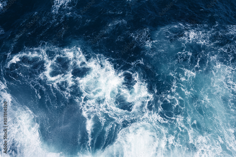 Top view on blue ocean waves. Nature background.