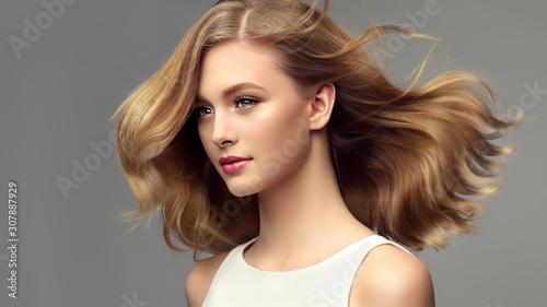 Slika na platnu Woman with curly beautiful hair  on gray background
