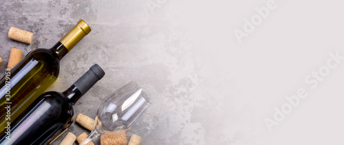 Fotografie, Obraz wine bottles and glass on table, top wiev,