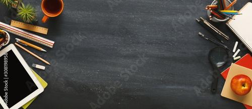 Foto Supplies for school border on black chalkboard, panorama