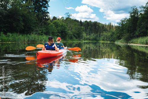 Canoe in river peaceful summer day Fototapeta