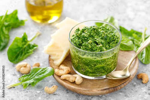 Fototapeta Spinach pesto sauce with cashew, parmesan cheese and olive oil