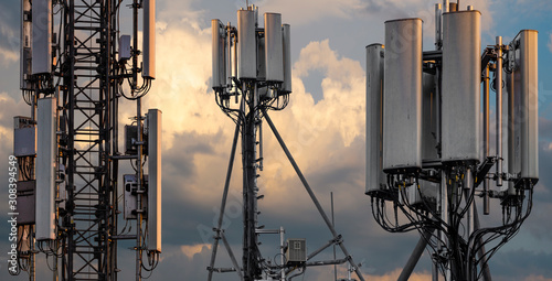 Fotografering base stations and mobile phone transmitters against the background of the evenin