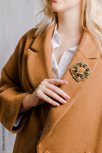 Canvas brooch in the shape of medal